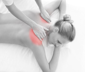 A woman getting massaging treatment over white background