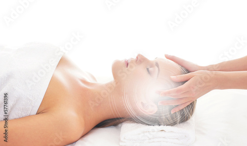 An attractive woman getting spa treatment on a white background