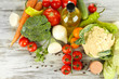 Fresh vegetables in basket on wooden table close-up