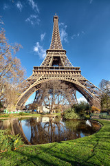 Wonderful wide angle view of Eiffel Tower with lake and vegetati