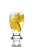 Sliced orange and lemon in glass of wate