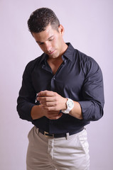 Man adjusting watch
