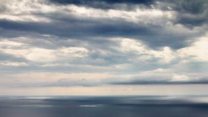 Sun beams over sea time lapse