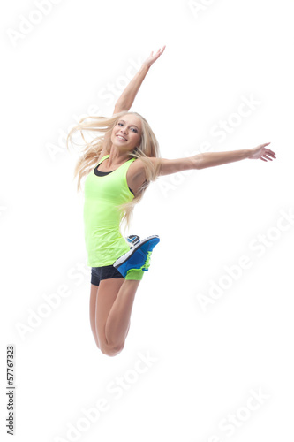 Image of cute young blonde posing in jump
