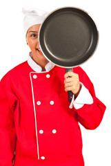 Chef woman behind frying pan