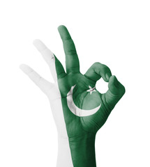 Hand making Ok sign, Pakistan flag painted