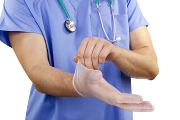 Doctor puts gloves