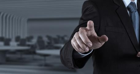 Businessman hand pressing an imaginary button