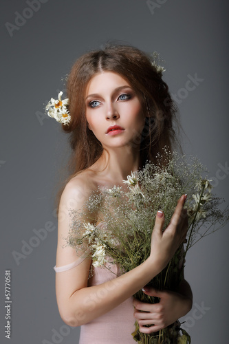 Sentimentality. Redhaired Muse with Flowers in Dreams