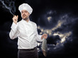 Young  chef with sea bass fish smoking cigar
