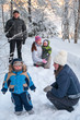 Women sisters with children and grandfather walking in winter