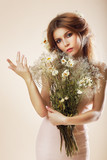 Simplicity. Elegant Woman with Bouquet of Flowers posing poster