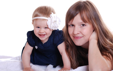 portrait of a beautiful baby girl with her mom