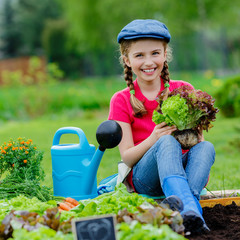 Garden, lettuce - girl working in vegetable garden