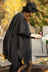 Mother at cemetery in fall