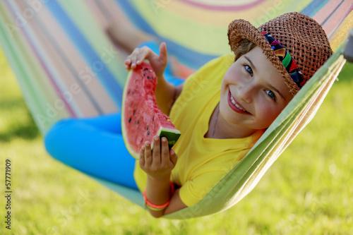 Summer joy - lovely girl eating fresh watermelon - 57771909