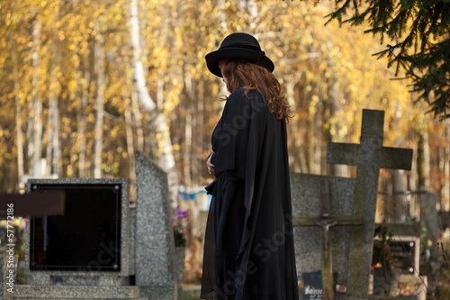 Widow looking at the gravestone