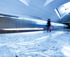 spacious public metro marble station with fast blurred train