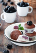 Chocolate muffins with blackberries, selective focus