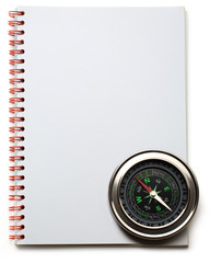 Compass and notebook