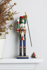 Christmas nutcracker solider broken with dead pine tree
