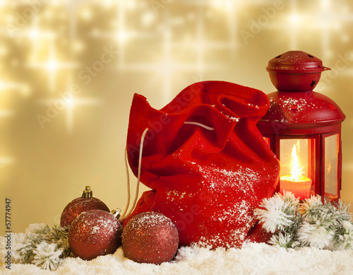 Christmas lantern gifts and baubles on snow abstract background