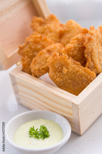 Crisp fish finger nugget in wooden box