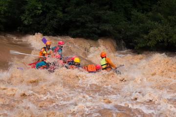 Travelers rafting with rubber boat