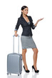 Businesswoman in full length with suitcase showing copy space