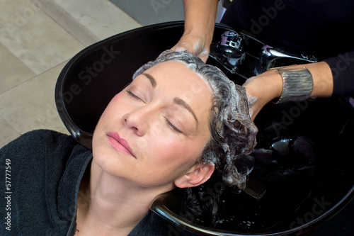 mature woman washing hair