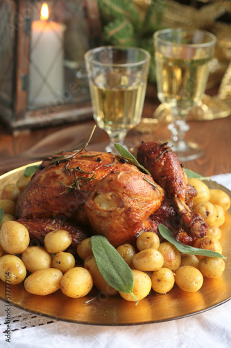 roast chicken with potatoes on new year's table