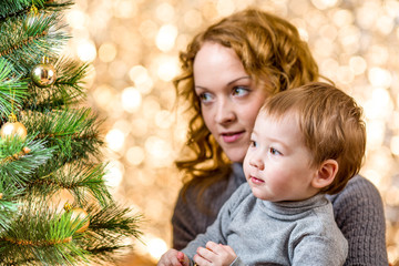 mother and kid boy at Christmas tree
