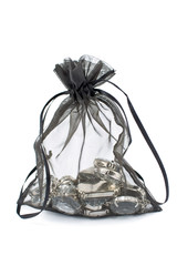 Black gift sack with diamonds isolated on white