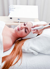 young woman in spa clinic