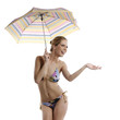 woman in bikini and holding an umbrella