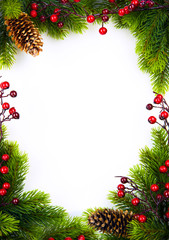 art   christmas frame with fir and Holly berry on white paper ba