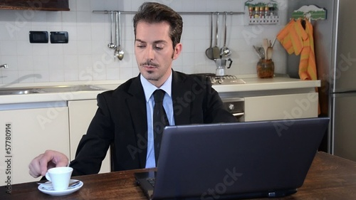 manager working at home and drinking coffee