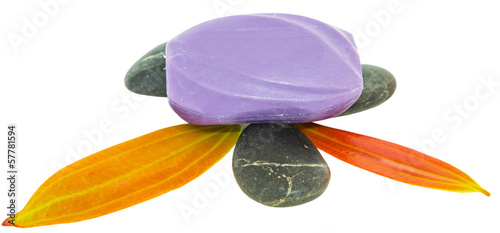 Soap with zen stones over white background
