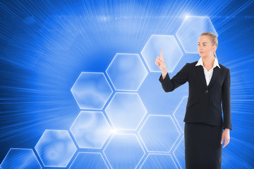 Composite image of young blonde business woman pointing