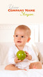 Baby manipulating green apple
