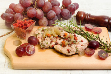 pork fillet with red grapes and goji berries