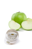 Apples and tape measure on the white background