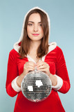 Beautiful woman in new year costume with a silver ball