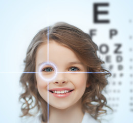 girl with eyesight testing board