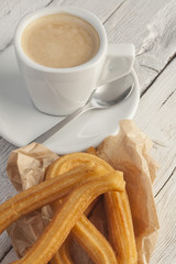 Breakfast with coffee and churros