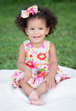 Hispanic toddler with an afro hairstyle
