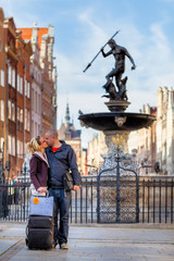 Kiss by the fountain of Neptune - Gdansk, Poland