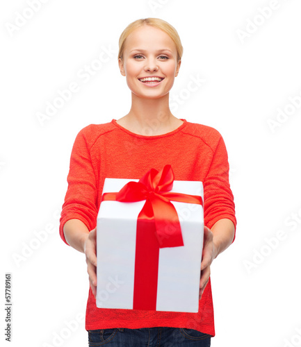 smiling woman in red sweater with gift box