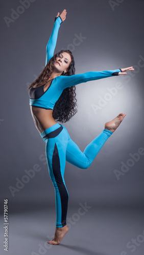 Graceful sporty woman posing in studio