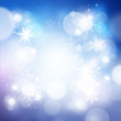 Shimmering Christmas Background with lights and snowflakes